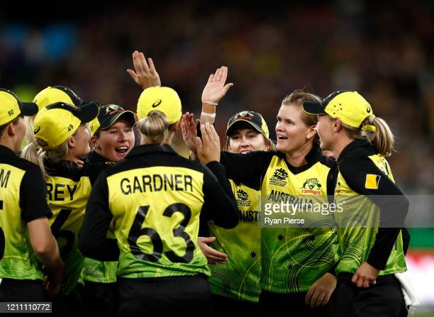 Jess Jonassen of Australia celebrates after taking the wicket of Harmanpreet Kaur of India during the ICC Women's T20 Cricket World Cup Final match...