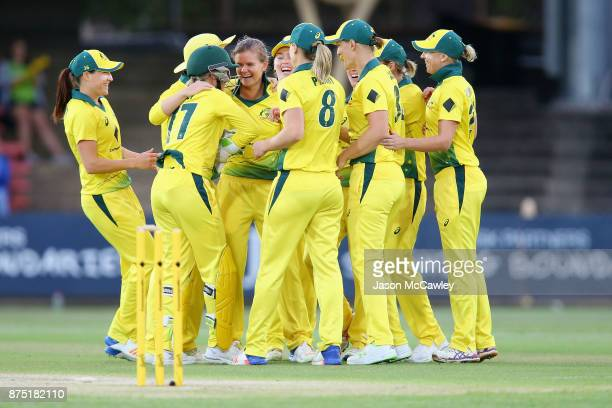 Jess Jonassen of Australia celebrates taking the wicket of Heather Knight of England during the first Women's Twenty20 match between Australia and...