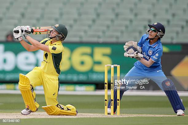 Jess Jonassen of Australia hits a ball high into the high and is caught by Veda Krishnamurthy of India during the women's Twenty20 International...