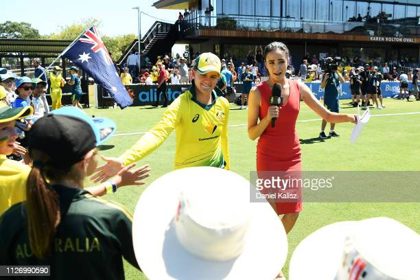 Jess Jonassen of Australia is interviewed by Abbey Gelmi of Channel Andre Heimgartner Cricket during game two of the One Day International Series...