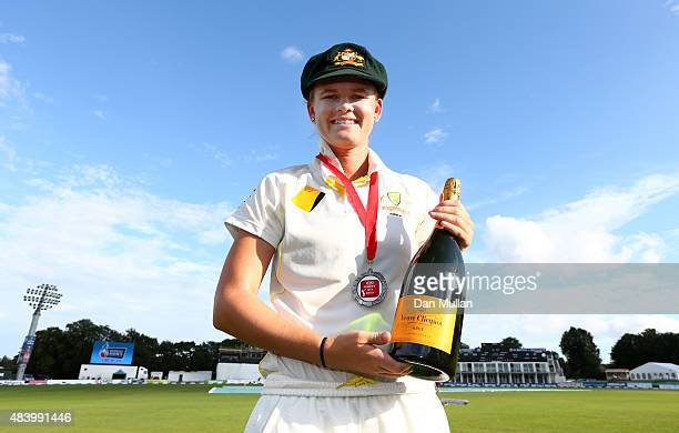 Jess Jonassen of Australia poses with her Player of the Game medal and celebratory bottle of champagne following victory during day four of the Kia...