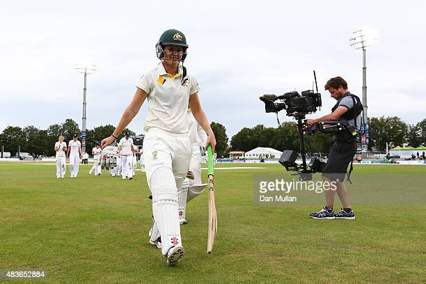 Jess Jonassen of Australia smiles as she leaves the field at the close of play on day one of the Kia Women's Test of the Women's Ashes Series between...