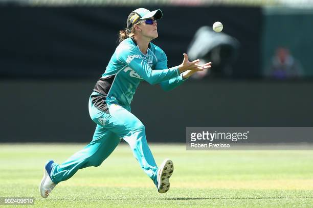 Jess Jonassen of the Brisbane Heat takes a catch to dismiss Emma Thompson of the Hobart Hurricanes during the Women's Big Bash League match between...