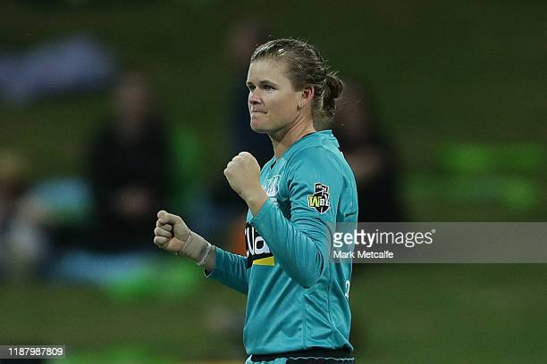 Jess Jonassen of the Heat celebrates taking the wicket of Hannah Darlington of the Thunder during the Women's Big Bash League match between the...