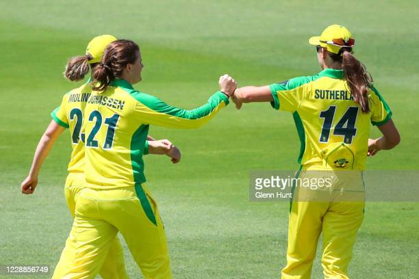 Jess Jonasssen of Australia celebrates with team mates after getting the wicket of Sophie Devine of New Zealand during game one in the women's One...