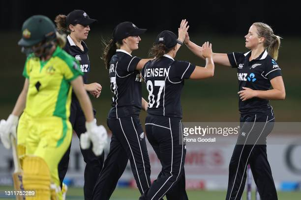 Jess Kerr of New Zealand takes the wicket of Nicola Carey of Australia during game three of the One Day International series between the New Zealand...