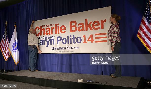 Jess Klarnet, left, and Jill Costello, right, both with High Output Production Co., prepare for Charlie Baker's election night party at the Seaport...