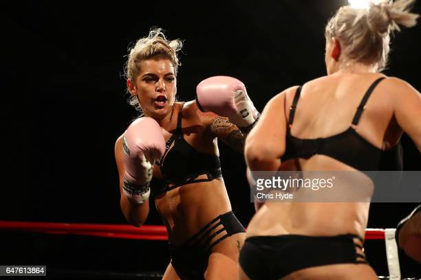 Jess Lee and Sharny Russell exchange punches during their lingerie bout during the Big Bangers Boxing Event on March 3 2017 in Gold Coast Australia