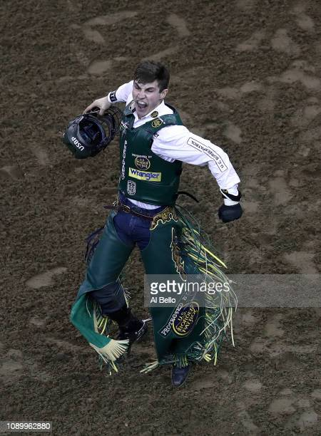 Jess Lockwood celebrates after riding Udder Lover during the PBR Unleash the Beast bull riding event at Madison Square Garden on January 04 2019 in...