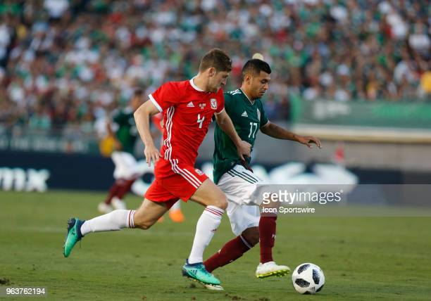 Jesús Mauel Corona of Mexico dribbles past Ben Davies of Wales during the game on May 28 at the Rose Bowl in Pasadena CA