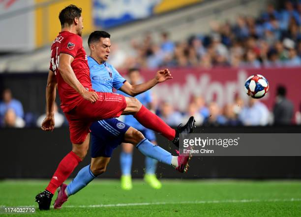 Jesús Medina of New York City FC and Omar González of Toronto FC reach for the ball at Yankee Stadium on September 11 2019 in the Bronx borough of...