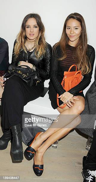 Jess Mills and Jessica Michibata sit in the front row at the Pringle Of Scotland Autumn/Winter 2012 show during London Fashion Week at Phillips de...