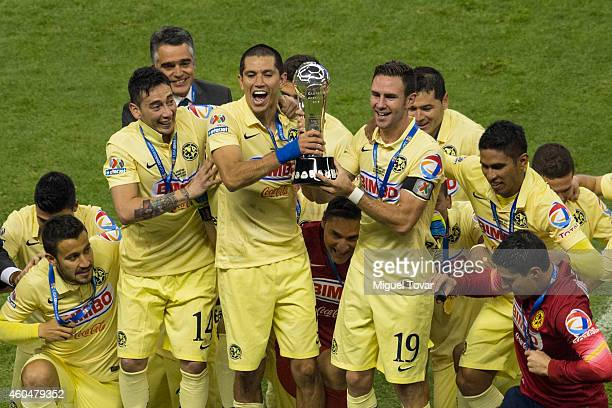 Jesús Molina and Miguel Layún of America lift the trophy after winning the final second leg match between America and Tigres UANL as part of the...