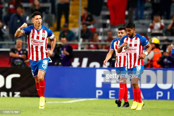 Jesús Molina of Chivas celebrates after scoring the first goal of his team during the 9th round match between Atlas and Chivas as part of the Torneo...