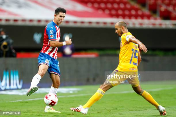 Jesús Molina of Chivas fights for the ball with Guido Pizarro of Tigres during the match between Chivas and Tigres UANL as part of the friendly...