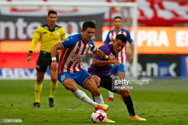 Jesús Molina of Chivas fights for the ball with Paul Rocha of Mazatlan during the match between Chivas and Mazataln FC as part of the friendly...