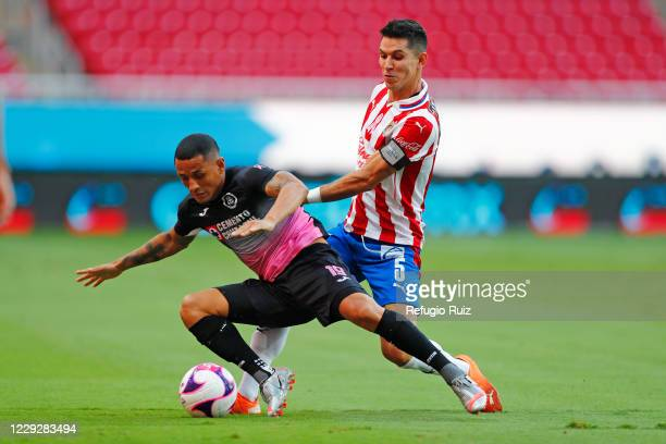Jesús Molina of Chivas fights for the ball with Víctor Yotun of Cruz Azul during the 15th round match between Chivas and Cruz Azul as part of the...