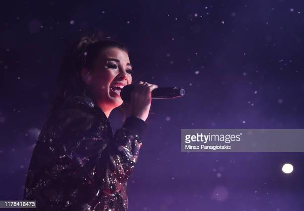 Jess Moskaluke performs during the second intermission as the Calgary Flames take on the Winnipeg Jets during the 2019 Tim Hortons NHL Heritage...