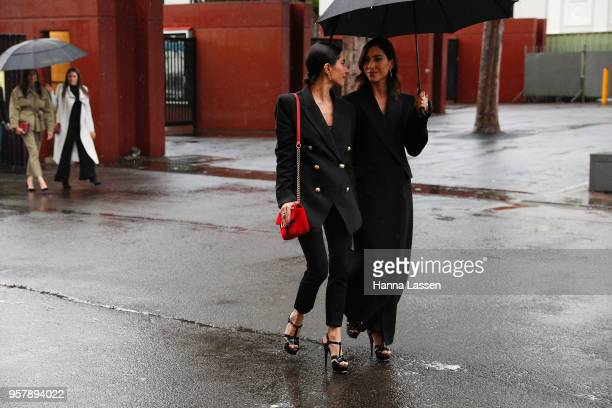 Jess Origliasso and Lisa Origliasso wearing Camilla and Marc suits and red velvet Gucci clutch during MercedesBenz Fashion Week Resort 19 Collections...