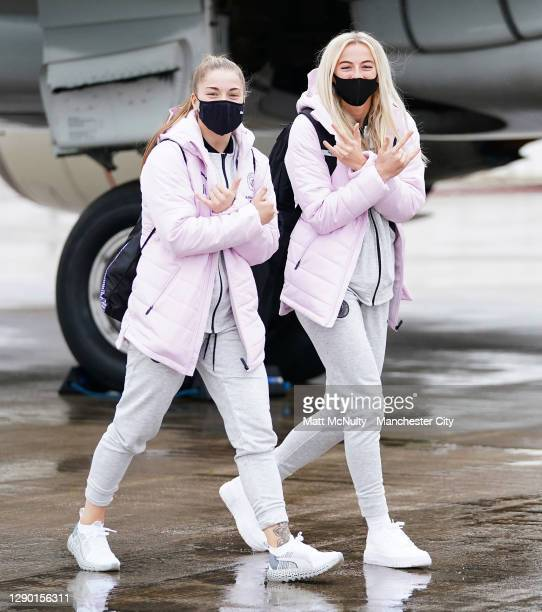 Jess Park and Chloe Kelly of Manchester City board the team flight at Manchester Airport for the trip to Gothenburg on December 08, 2020 in...