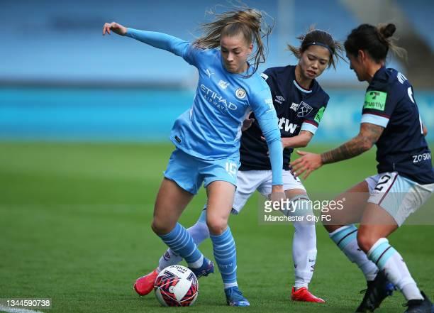 Jess Park of Manchester City Women beats Zaneta Wyne of West Ham United Women during the Barclays FA Women's Super League match between Manchester...