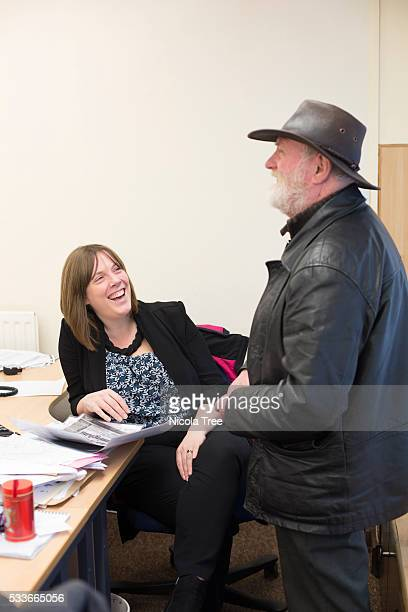 Jess Phillips in her Birmingham yardley constituency office speaking with a constituent