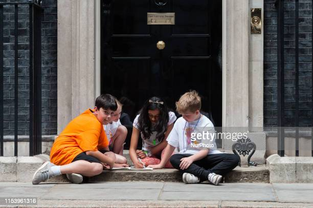 Jess Phillips Labour MP for Birmingham Yardley leave children including her 10yearold son Danny on the steps of 10 Downing Street in a protest over...