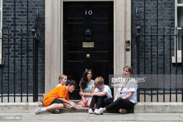 Jess Phillips Labour MP for Birmingham Yardley together with her 10yearold son Danny and primery school children on the steps of 10 Downing Street...