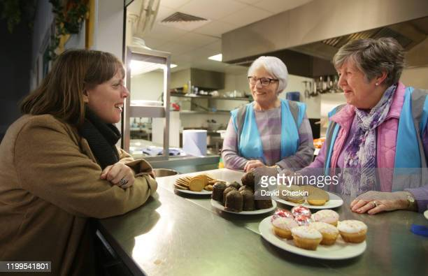 Jess Phillips talks cafe staff after arriving at a city centre homeless shelter on January 14 2020 in Glasgow Scotland