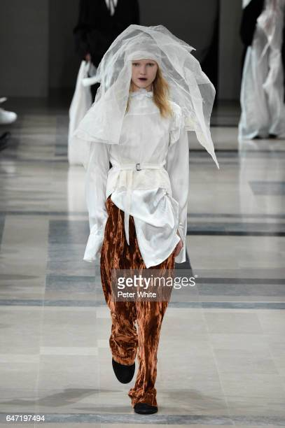 Jess PW walks the runway during the Ann Demeulemeester show as part of the Paris Fashion Week Womenswear Fall/Winter 2017/2018 on March 2, 2017 in...