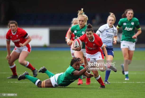 Jess Roberts of Wales makes a break past Linda Djougang of Ireland during the Women's Six Nations match between Wales and Ireland at Cardiff Arms...