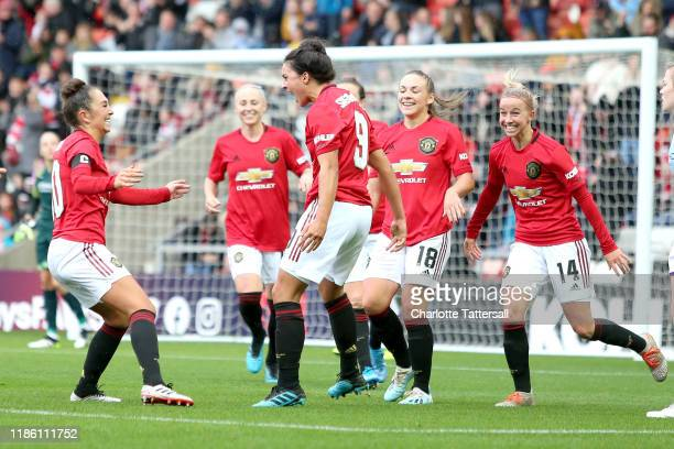Jess Sigsworth of Manchester United celebrates after scoring her sides second goal during the FA Women's Continental League Cup match between...