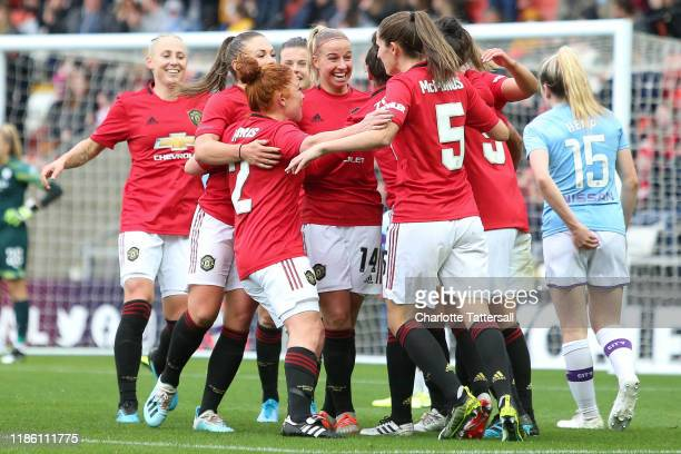 Jess Sigsworth of Manchester United celebrates with her team mates after scoring her sides second goal during the FA Women's Continental League Cup...