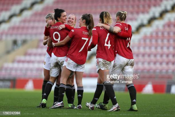 Jess Sigsworth of Manchester United celebrates with Jackie Groenen, Ella Toone, Amy Turner and team mates after scoring their sides third goal during...
