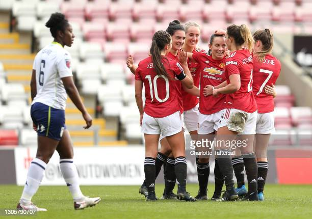 Jess Sigsworth of Manchester United celebrates with team mates after scoring their side's second goal during the Barclays FA Women's Super League...