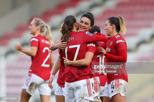 Jess Sigsworth of Manchester United celebrates with team mates Tobin Heath and Amy Turner after scoring their sides third goal during the Barclays FA...