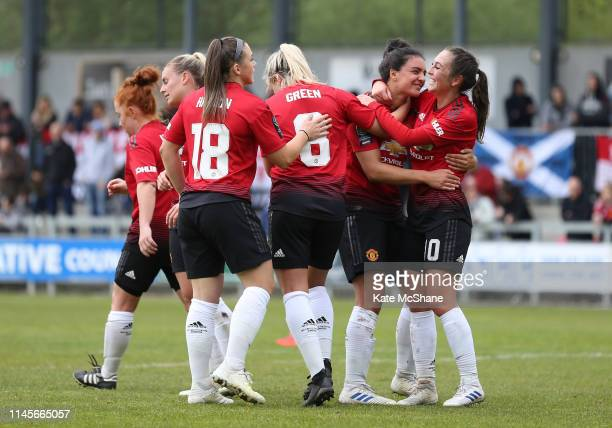 Jess Sigsworth of Manchester United Women celebrates scoring her team's fifth goal with team mates during the FA Women's Championship match between...