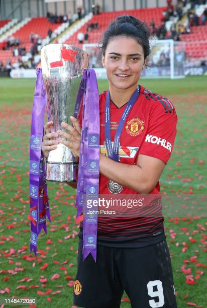 Jess Sigsworth of Manchester United Women poses with the FA Women's Championship trophy after the WSL match between Manchester United Women and Lewes...