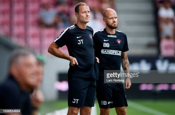 Jess Thorup head coach of FC Midtjylland and Kristian Back Bak assistant coach of FC Midtjylland looks on during the Danish Superliga match between...