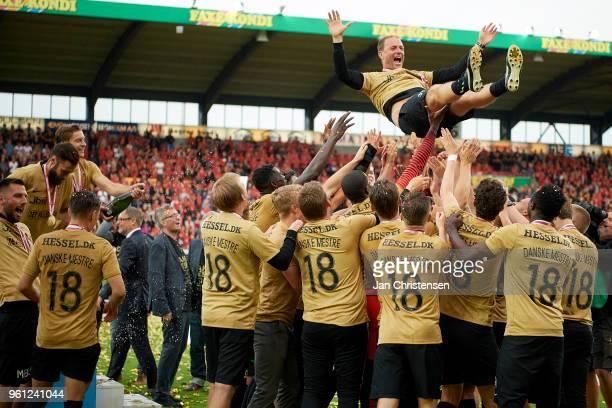 Jess Thorup head coach of FC Midtjylland and players of FC Midtjylland celebrating the Danish Championship after the Danish Alka Superliga match...