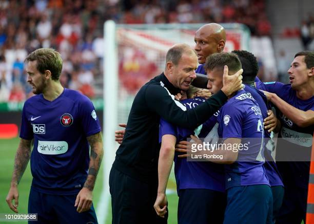 Jess Thorup head coach of FC Midtjylland celebrates with his players after the 31 goal scored by Mads Dohr Thychosen of FC Midtjylland during the...
