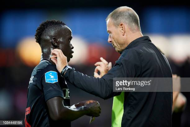 Jess Thorup head coach of FC Midtjylland speaks to Awer Mabil of FC Midtjylland during the Danish Superliga match between FC Midtjylland and FC...