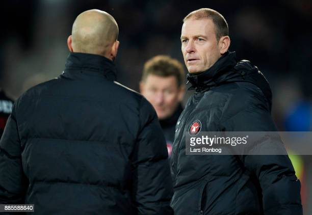 Jess Thorup head coach of FC Midtjylland speaks to Kristian Bach Bak assistant coach of FC Midtjylland during the Danish Alka Superliga match between...