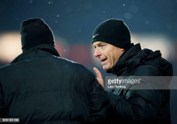 Jess Thorup head coach of FC Midtjylland speaks to Rafael van der Vaart of FC Midtjylland during the Danish Alka Superliga match between FC...