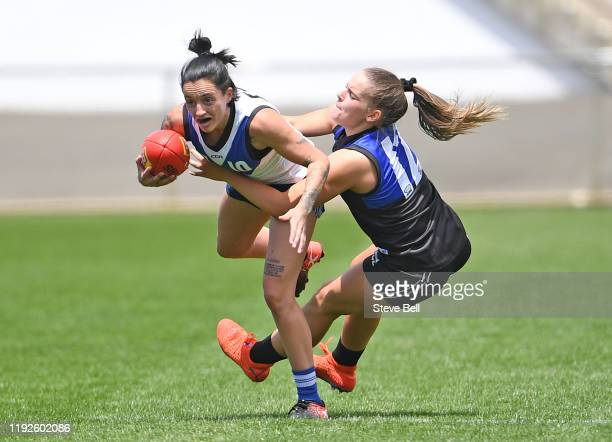 Jess Trend of the Kangaroos is tackled during a North Melbourne Kangaroos AFLW Match Simulation Training Session at North Hobart Oval on December 08,...