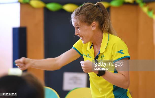Jess Trengove goes through her warm up routine with teachers and students during the Commonwealth Games Schools Assembly at Pennington Primary School...