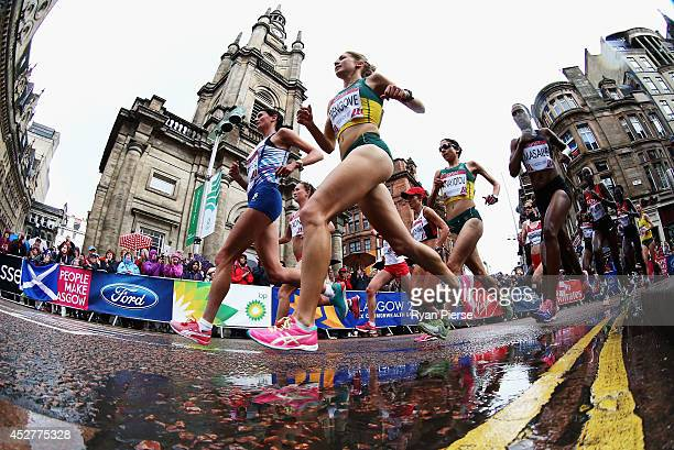 Jess Trengove of Australia and Susan Partridge of Scotland lead the field past St Georges Tron Church during the Women's Marathon during day four of...