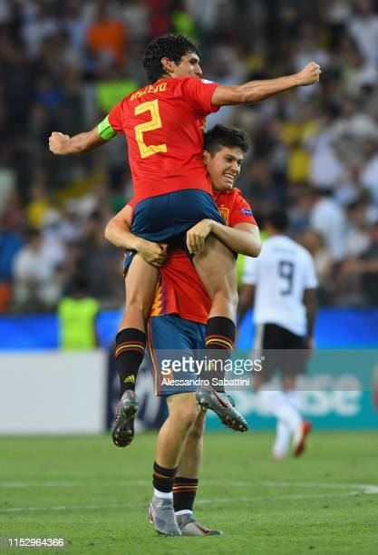 Jesús Vallejo, Jorge Meré of Spain celebrate the victory after the 2019 UEFA U-21 Final between Spain and Germany at Stadio Friuli on June 30, 2019...