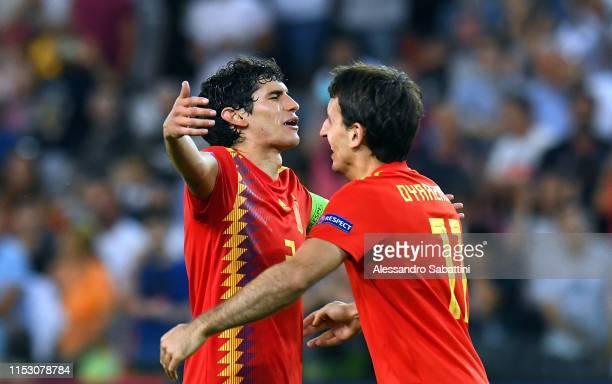 Jesús Vallejo, Mikel Oyarzabal of Spain celebrate the victory atthe end the 2019 UEFA U-21 Final between Spain and Germany at Stadio Friuli on June...