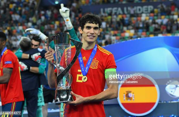 Jesús Vallejo of Spain celebrates the victory with the trophy at the end the 2019 UEFA U-21 Final between Spain and Germanyat Stadio Friuli on June...